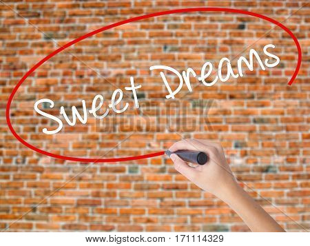 Woman Hand Writing Sweet Dreams With Black Marker On Visual Screen