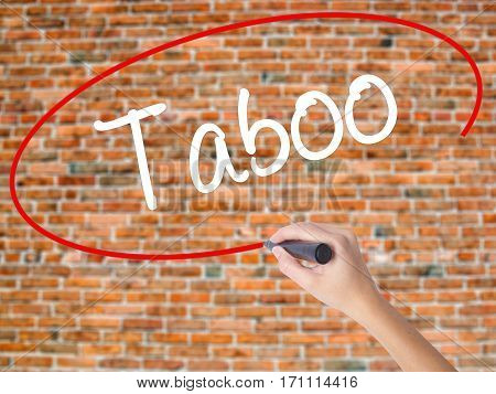 Woman Hand Writing Taboo With Black Marker On Visual Screen