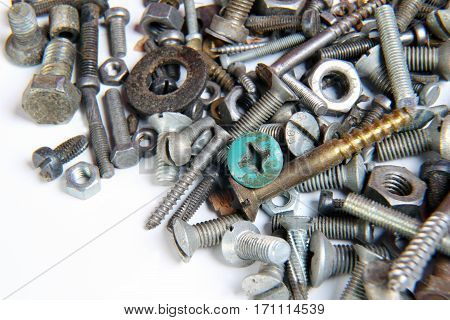 A lot of screws and nuts on a white background