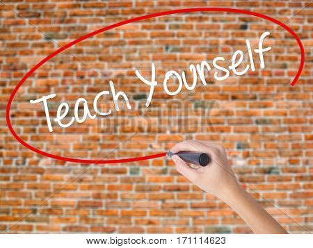 Woman Hand Writing Teach Yourself  With Black Marker On Visual Screen