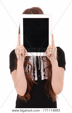 Girl keeps tablet pc in front of face isolated on white