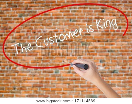 Woman Hand Writing The Customer Is King With Black Marker On Visual Screen
