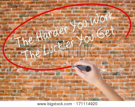 Woman Hand Writing The Harder You Work The Luckier You Get  With Black Marker On Visual Screen