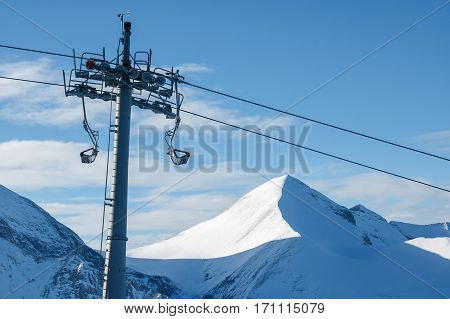 Chair lift on a background of mountains and sky. Bansko, Bulgaria