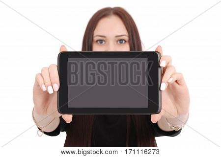 Smiling student teenage girl showing a tablet display application isolated on white. Focus on tablet pc