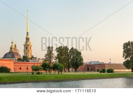 Peter and Paul fortress and cathedral in summer sunset, Saint Petersburg