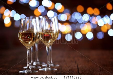 Glasses of wine in a row on bokeh background