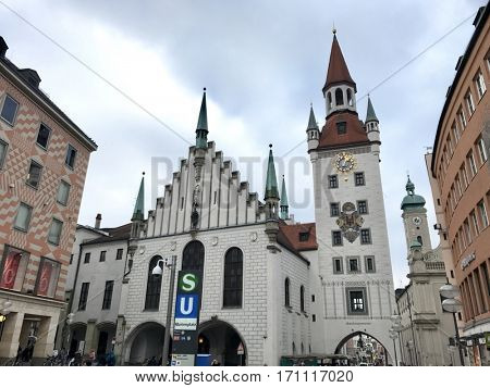 MUNICH - FEBRUARY 9, 2017: Local pedestrians and sightseeing tourists outside the Altes Rathaus Old Town Hall at Marienplatz in Munich, Bavaria, Germany.
