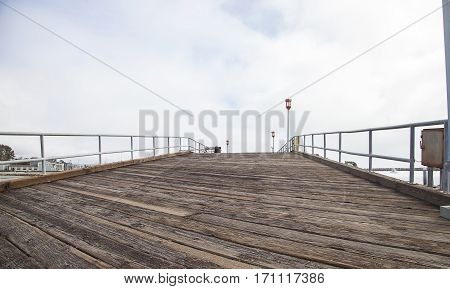 Small wooden pier in Dana Point Harbor in Southern California USA