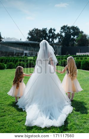 The bride accompanied by two little girls.