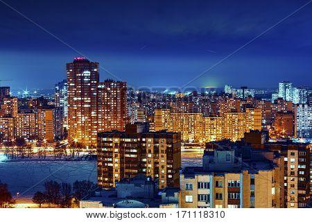 Skycrapers in Kiev, Ukraine, on the backround of illumination skyline. Magic blue hour cityscape