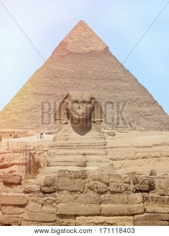 View of the Sphinx head with pyramid in Giza near Cairo Egypt.