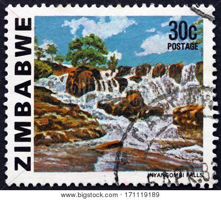 ZIMBABWE - CIRCA 1980: a stamp printed in Zimbabwe shows Inyangombe Falls circa 1980