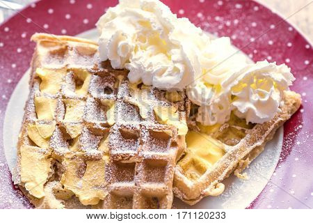 Dessert with soft waffle and spread with butter