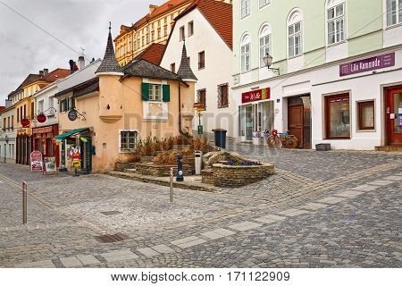 MELK/ AUSTRIA - FEBRUARY 23 2016: The medieval buildings around the square Rathausplatz in the town of Melk. View of the old bread shop from 15 century with two corner towers in the late Gothic style. Melk, Austria.