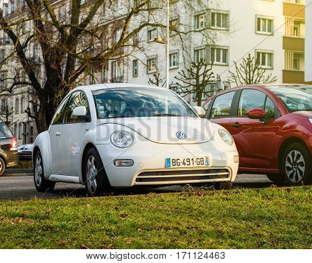 STRASBOURG FRANCE - FEB 2 2017: Volkswagen VW Beetle Coccinelle car parked in urban environment. On 18 September 2015 the United States Environmental Protection Agency (EPA) issued a notice of violation of the Clean Air Act to German automaker Volkswagen