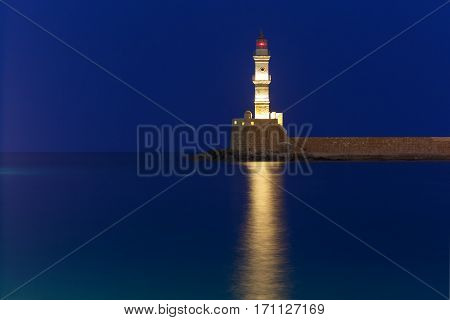 Picturesque view of Lighthouse in old harbour of Chania during twilight blue hour, Crete, Greece