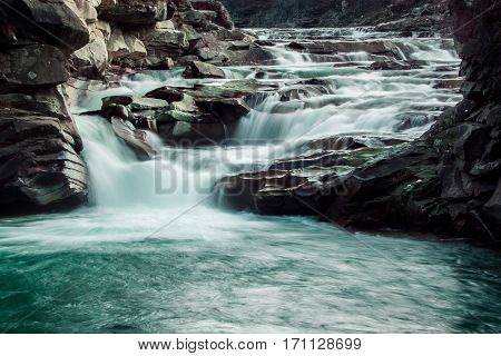 Nature and fast flowing of a mountain river.