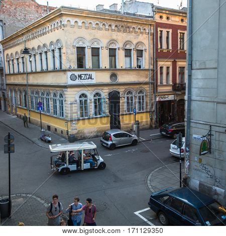 KRAKOW, POLAND - SEP 7, 2016: One of the streets in historical center of city. In 2000, Krakow was named European Capital of Culture, the city hosted the World Youth Day in July 2016.