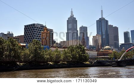 Melbourne Australia - Jan 4 2017. Looking across the Yarra River to the city of Melbourne. Skyscrapers of Melbourne Central Business District in Australia.