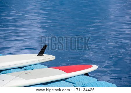 A Pair Of Single Stand Up Paddle In A Row 03