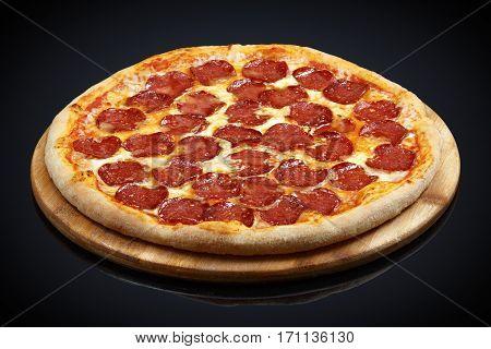 Pizza pepperoni, mozzarella, oregano on a black background