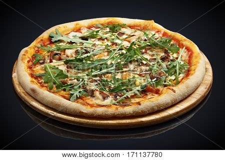 Pizza BBQ with arugula on a black background