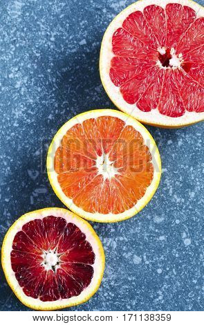 Citrus fruits on stone background with copy space
