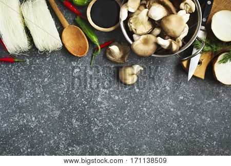 Cooking food background. Food ingredients: oyster mushrooms soy sauce hot peppers and rice noodles.