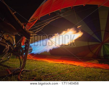 Hot flames bursts into the hot air balloon, getting ready for the ascent.