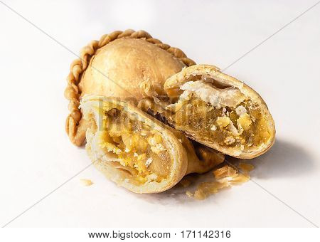 curry puff stuffed chicken on white background