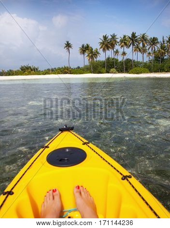 Paradise tropical Maldives island with white sand beach, woman in canoe travel concept