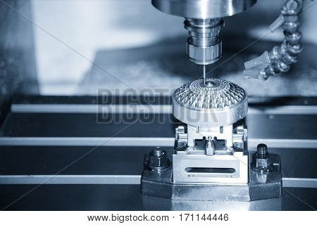 The Hi-precision CNC milling machine with cutting sample in blue-silver tone.
