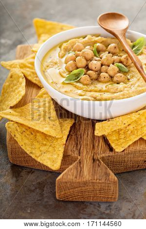 Homemade hummus with tortilla chips, small appetizers