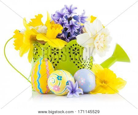 Easter eggs with spring flowers in watering can. Isolated on white background