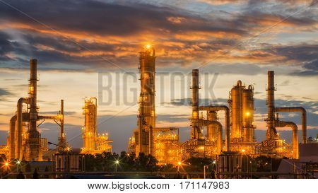Oil refinery factory with sunrise background Pipe oil tank and factory energy and air polution concept.