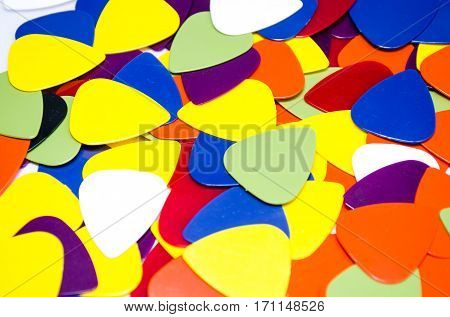 plectrum or Pick for guitar, music colorful background