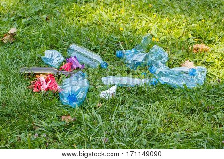 Heap Of Rubbish On Grass In Park, Littering Of Environment