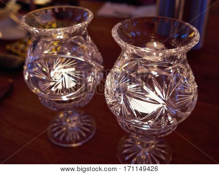 Beautiful traditional design classical glass candle holders burning candles inside