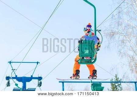 Snowboarder Rises To The Chairlift To The Track