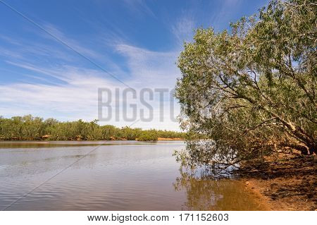 The Coongen River runs through the Pilbara region of Western Australia during the wet season, although this particular day a blue summer sky was overhead. Western Australia, Australia.