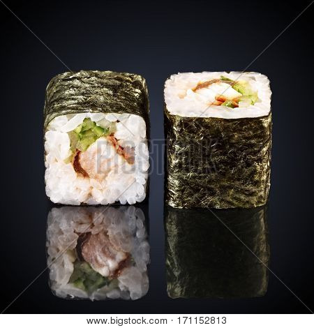 unagi rolls spicy roru with eel on a black background