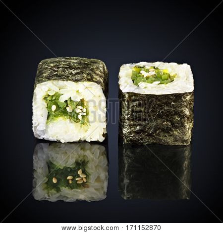 Chuka seaweed rolls on a black background
