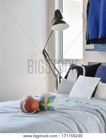 Stylish Bedroom Interior Design With Blue Patterned Pillows On Bed And Decorative Table Lamp.