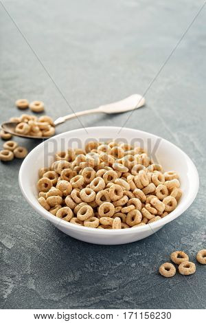 Healthy cold cereal in a white bowl, quick breakfast or snack for children