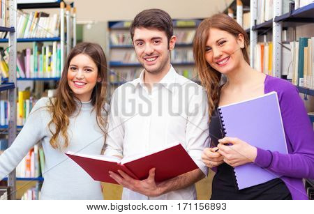 Smiling students in the university library