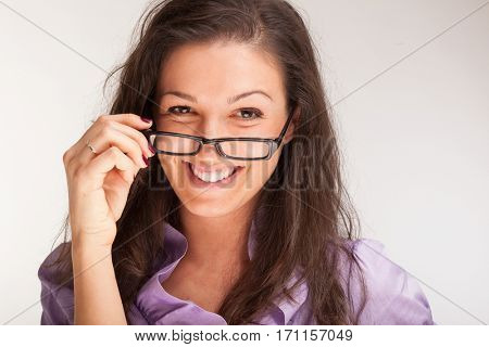 Portrait of a woman holding her glasses