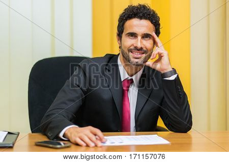 Handsome businessman in his office