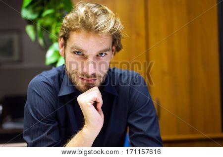 Handsome businessman portrait at his desk