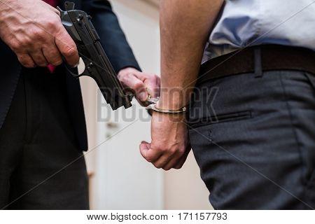 Policeman arresting a criminal